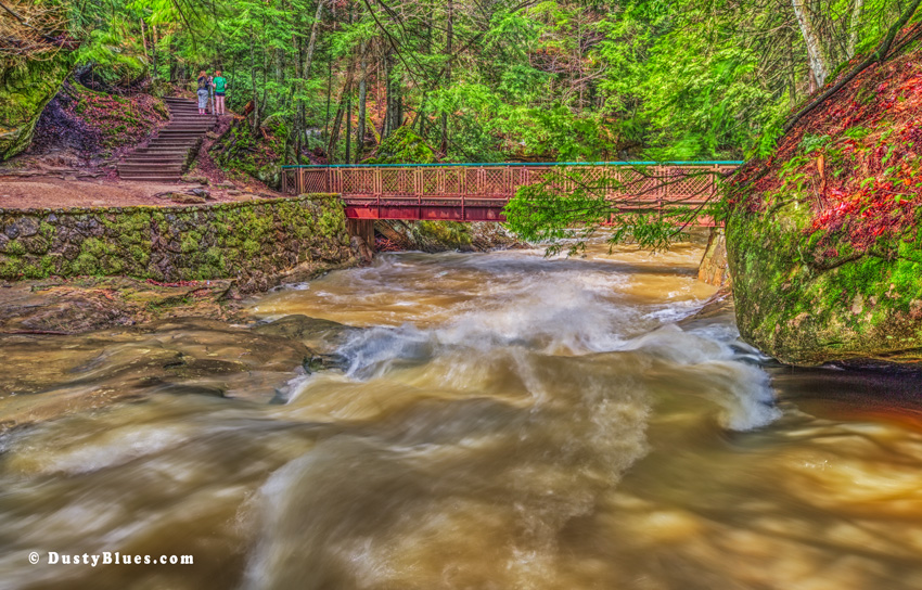 A Spring flood rage from Cedar Falls downstream under the Bridge Foot path. Thunderous sounds cascaded past me as I captured this. Dusty